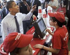 President Obama orders lunch May 29 at a Five Guys Burgers and Fries in Washington, D.C.