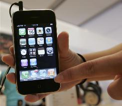 A customer uses an iPhone at an Apple store in Palo Alto, Calif., in October 2008.