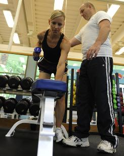 Megan Hurley, senior legal counsel at PepsiCo, works out at PepsiCo headquarters in Purchase, N.Y., with the help of massage therapist and personal trainer John Monroe.