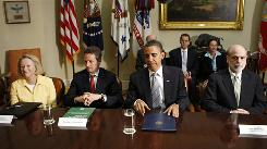 President Obama on Wednesday with, from left, SEC Chairman Mary Schapiro, Treasury Secretary Tim Geithner and Fed Chairman Ben Bernanke.
