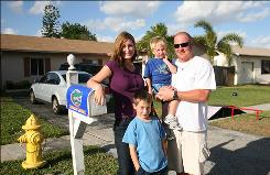 The Petty family includes, from left, Kara, Aiden, 6, Landon, 2, and Cliff in front of their home in Sunrise, Fla. They were paying about $1,000 a month for child care.