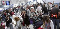 Travelers wait in lines at O'Hare International Airport in Chicago on May 22.