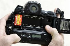 In this Sept. 15, 2008, file photo, a roll of Kodachrome 64 is loaded into a film camera in Tonawanda, N.Y.