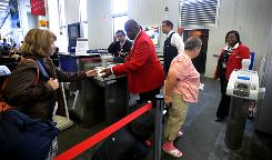 Red Coat Headley Walker, 61, center, helps fliers at JFK. Delta is putting its Red Coats, those distinctive airport agents of yesteryear when airlines stressed personal service, back in action. They'll help customers with everything from printing boarding passes to getting to the right concourse.