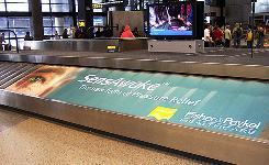 At Sea-Tac, ads such as this one for SensAwake are appearing on baggage carousels in some airports.