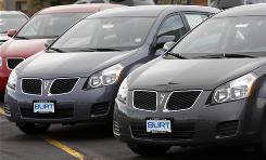 Unsold 2009 Pontiac Vibes sit at a dealership in Littleton, Colo. GM said it will stop making the Pontiac Vibe small car in August at a factory it runs jointly with Toyota in Freemont, Calif.