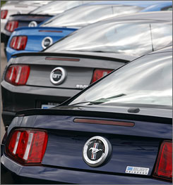 2010 Mustangs and Mustang GT's are ready to be sold at a Ford dealership in the Colorado city of Centennial on Sunday, June 28, 2009.