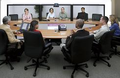 Marriott International and Starwood Hotels are introducing expensive videoconferencing systems at several properties.
