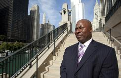 Derrick Johnson, vice president of Zeller Realty Group, outside the firm's offices on Michigan Avenue in Chicago.