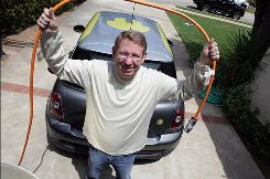 """Peter Trepp of Los Angeles shows off his Mini E on May 27. """"It's been so much fun,"""" he says."""