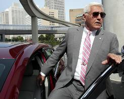 General Motors Vice Chairman Bob Lutz with a 2010 Buick LaCrosse in front of GM headquarters in Detroit on July 10. &quot;There's a lot of stuff that irks me&quot; with GM's current advertising, Lutz says. 