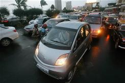 The Tata Nano car hits the streets of Mumbai as the world's cheapest car, priced at $2,000 U.S.
