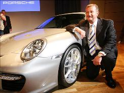 Wendelin Wiedeking, former CEO of Porsche, poses with a Porsche GT 2 at the Frankfurt International Auto Show in 2007. Wiedeking was forced to leave Porsche after a failed takeover bid of VW.