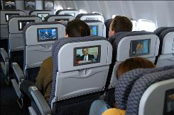 Continental is loading its jets with satellite TV so fliers can watch what they want, live, at their seats.