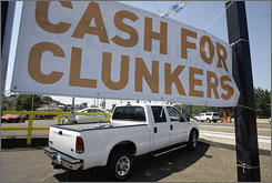 "A ""cash for clunkers"" sign at a Subaru car dealership in Oregon City, Ore., on Monday, July 27, 2009."