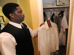 Cledor Datis delivers a freshly pressed shirt to a guest's closet at the Omni Shoreham Hotel in Washington, D.C.
