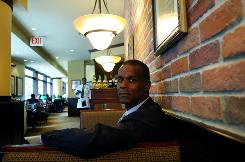 Darden Restaurants CEO Clarence Otis is leery of layoffs in company eateries, including Red Lobster and Olive Garden, as a way of dealing with the recession.
