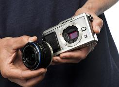 The Olympus Pen E-P1 is the smallest 12-megapixel camera with interchangeable lenses.