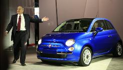Chrysler's Jim Press introduces a Fiat 500 in April at the 2009 New York International Auto Show in New York.