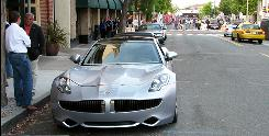 The Fisker Karma makes its debut on the streets of Monterey, Calif., earlier this month. The car could easily top 100 miles per gallon, its designer says.
