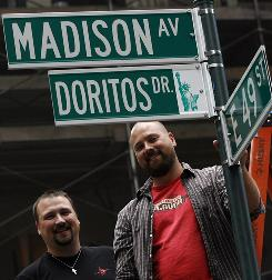Brothers Joe Herbert, left, and Dave Herbert, winners of the 2009 Doritos Super Bowl ad contest, in New York. Madison Avenue will be known today as Doritos Drive to launch the 2010 contest.