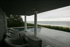 A view of the pool, at left, and the ocean from the porch of the house of Bernard Madoff in Montauk, New York.