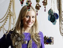 Ali Galgano, owner of Charm & Chain, poses with some of her costume jewelry. She used to be a corporate recruiter.