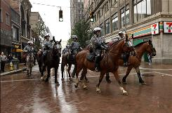 Mounted police patrol the streets of downtown Pittsburgh on Wednesday in preparation for the G-20 summit.