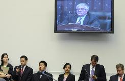Staff members listen to Rep. Barney Frank's opening remarks Wednesday.