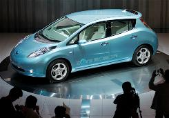 Nissan shows off its Leaf electric car.