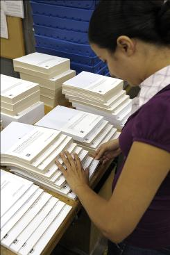 Benefits documents for open enrollment season are being sorted and packaged for shipment on Sept. 24 at RR Donnelley in Lancaster, Pa.