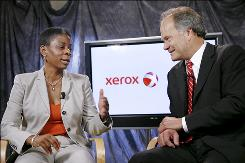 Xerox CEO Ursula Burns and Affiliated Computer Services CEO Lynn Blodgett at Xerox headquarters in Norwalk, Conn.