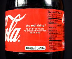Bottles of Coca-cola will show calorie count information on the front, off to the side.