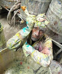"""Mike Rowe sorts paints for use in Third World countries on Discovery's """"Dirty Jobs."""""""