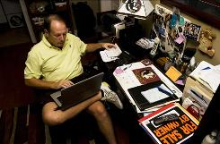 Mike Cannington searches the Internet for job openings in his Fort Myers, Fla., home on Sept. 17.