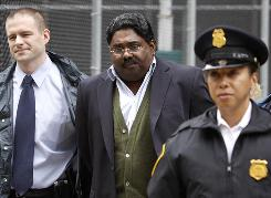 Galleon hedge fund partner Raj Rajaratnam is escorted by FBI agents after being taken into custody.