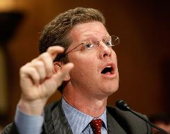 Housing and Urban Development Secretary Shaun Donovan testifies before the Senate Banking, Housing and Urban Affiars Committee.