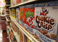 Boxes of cerea lline the shelf at a grocery store in Berkeley, California. Consumer groups have complained about lax standards for food labels for everything from cereal to crackers.