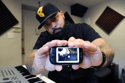 "Kevin Lomax, a 29-year-old singer/songwriter/producer in New York, is one of the millions of consumers using mobile phones exclusively to access social networks. ""These days, who carries a laptop unless you are a businessman?"" he says."