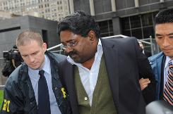 Galleon Group founder Raj Rajaratnam is led from FBI headquarters in New York on Friday.