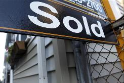 Home resales rose far more than expected last month to the highest level in more than two years as buyers scrambled to complete their purchases before a tax credit for first-time owners expires.