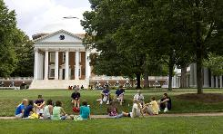 Students congregate on the campus of the University of Virginia. College tuition rose across all types of colleges again this year.