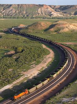 A BNSF train carries coal from the North Antelope Rochelle mine southeast of Gillette, Wyo., in this file photo.