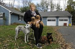 Sharon Sakson with, from left, Scout, Katie, Stella, Clarissa and Nessie. Sakson is walking away from her Pennington, N.J., home.