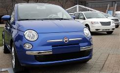 A 2009 Fiat 500 vehicle sits outside Chrysler headquarters. Chrysler said the 500 is coming to the United States.