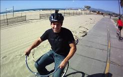 Marc Barros, with his ContourHD1080p helmet cam, in Venice Beach, Calif., is photographed by the same model camera.