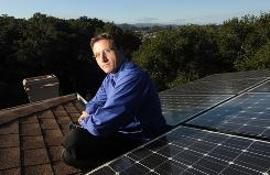 SolarCity CEO Lyndon Rive with solar panels atop his Belmont, Calif., home on Nov. 4. He says company revenue will grow 40% this year.