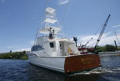 Bernard Madoff's boat, Bull, cruises a waterway in Fort Lauderdale. It will be sold at auction next week in Florida.