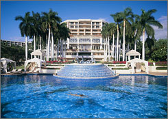 The Grand Wailea is a high-end hotel on Maui occupying 40 acres fronting serene beaches.