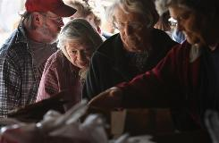 Rural residents wait their turn to receive donated food at an aid distribution site in Eads, Colo. Forty-nine million Americans had to face hunger in 2008.